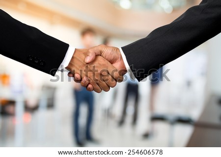 Business handshake in office  - stock photo