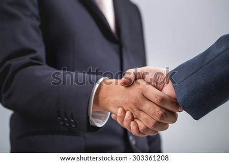 Business handshake ,Investment concept - stock photo