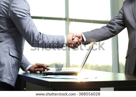 Business handshake. Morning at the office - stock photo