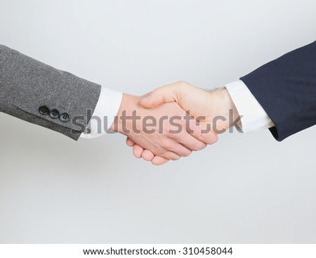 Business Handshake of Two Man in Suits - stock photo