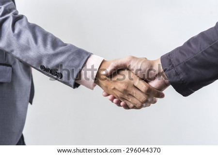 Business handshake on grey background