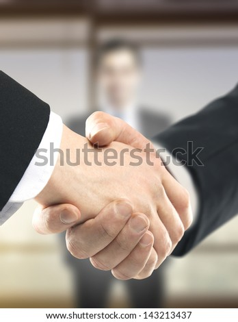 business handshake on people background