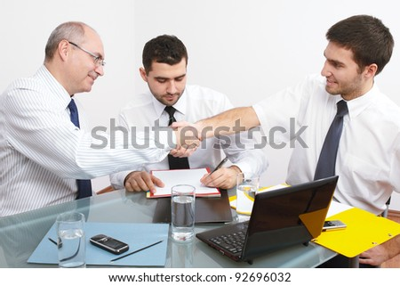 Business handshake over just signed contract or agreement.