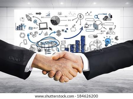 Business Handshake Strategic Planning - stock photo
