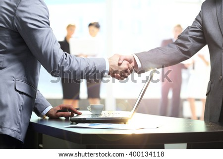 Business handshake. Two businessman shaking hands in the office. - stock photo