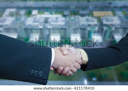 Business handshake with blur background of business buildings area and office, cityscape - stock photo