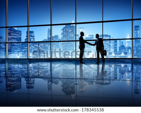 Business Handshake with City Skyline