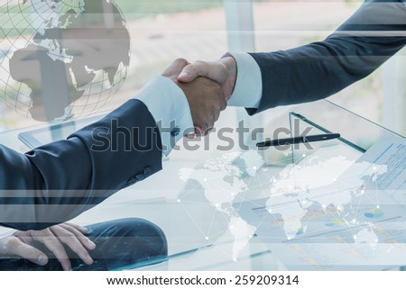 Business handshake with globalization concept - stock photo
