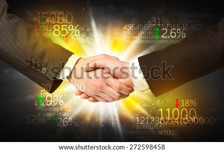 Business Handshake with number analysis - stock photo