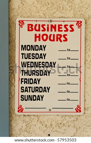 Business Hours on Office Store Front - stock photo