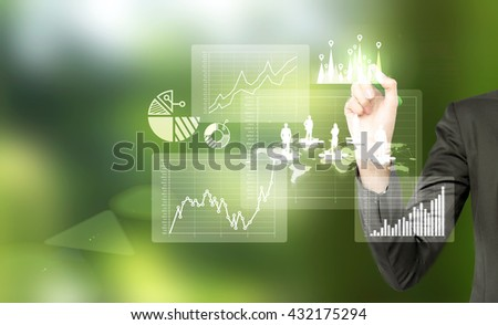 Business, HR and teamwork concept  with businesswoman hand drawing abstract chart and puzzle pieces with people silhouettes on green background - stock photo