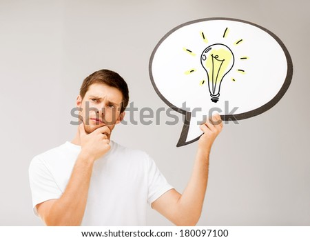 business idea concept - picture of thinking young man with ligth bulb in text bubble - stock photo