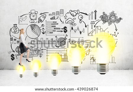 Business idea concept with businesswoman climbing abstract light bulb ladder with business sketch in the background - stock photo