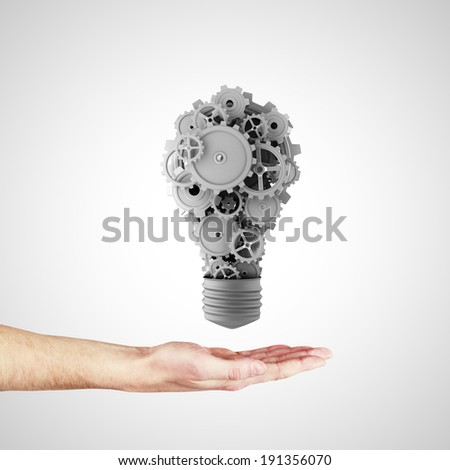Business ideas and concepts featuring a light bulb with gears - stock photo
