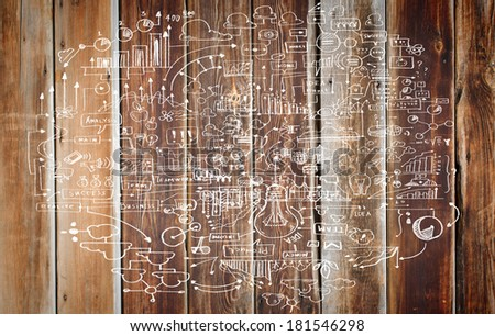 Business ideas and sketch on wooden surface - stock photo