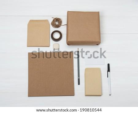 Business Identity Mockup Item Set On White Wooden Desk - stock photo