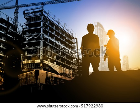 Business Industrial,People,personal and career growth, progress and potential concepts.silhouette Businessman engineer looking blueprint in a building site over Blurred construction site. film grain