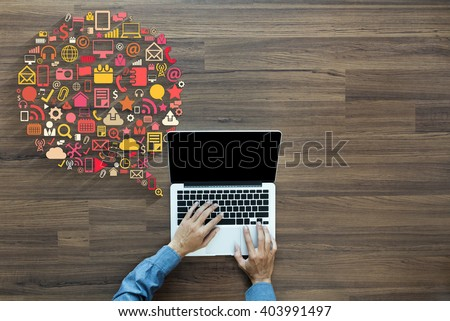 Business innovation technology set application icons, With businessman working on laptop computer PC on wood table, view from above