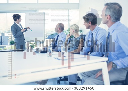 Business interface with graphs and data against business people listening during meeting - stock photo