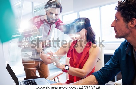Business interfaces against colleagues using technology - stock photo