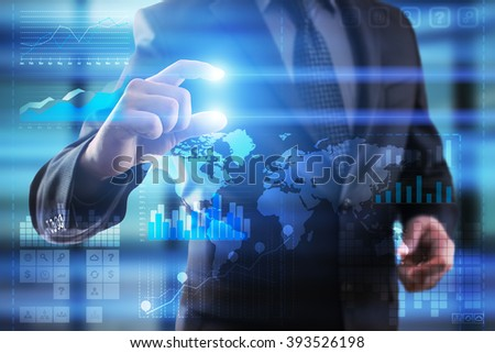 Business, Internet and technology concept.  Businessman using modern computer with grahs icons and world map. template.