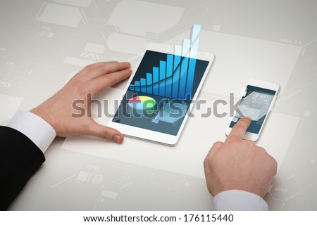 business, internet and technology concept - close up of businessman hands working with table pc and smartphone - stock photo