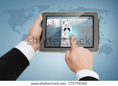 business, internet and technology concept - close up of man hands touching tablet pc