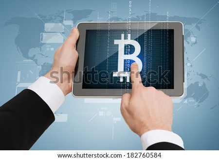 business, internet and technology concept - close up of man hands touching tablet pc with bitcoin symbol - stock photo