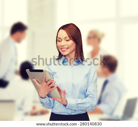 business, internet and technology concept - smiling woman looking at tablet pc computer at office - stock photo