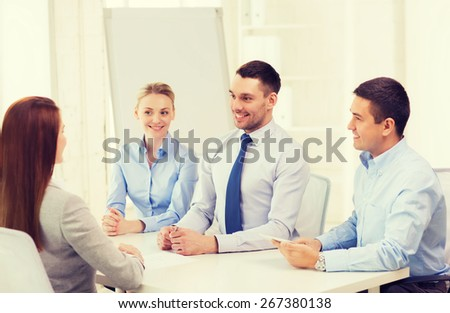 business, interview, employment and office concept - business team with tablet pc computer interviewing worker in office - stock photo