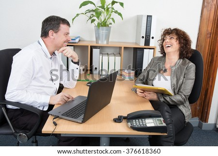 Business interview in a office man and woman at desk