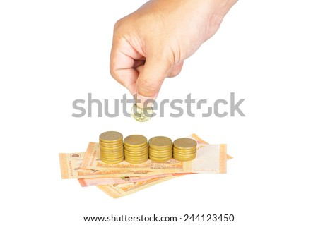 Business, investment or education saving concept - Hand putting coins to add to the fund isolated on white. - stock photo
