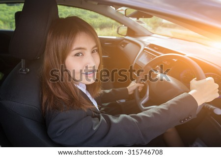 Business is smile and happy because she love drive car. - stock photo