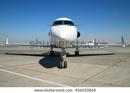 Business jet parked on the ramp - stock photo