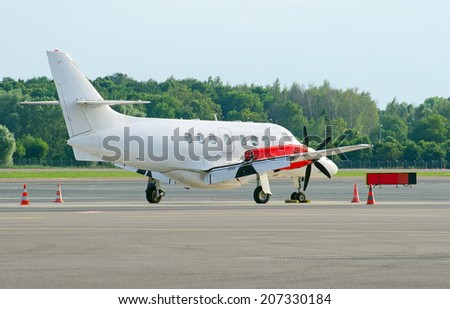 Business jet plane parked on airfield. - stock photo