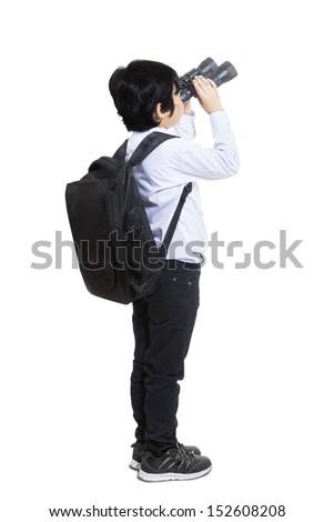 Business kid is using binoculars on white background - stock photo