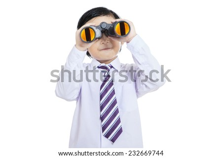 Business kid looking through binoculars on white background - stock photo