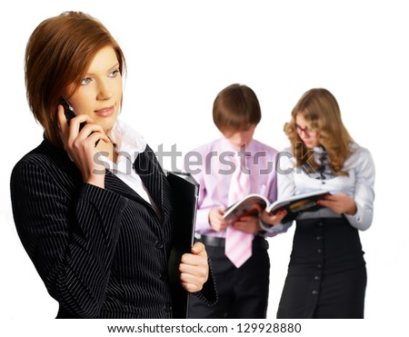 Business lady at colleagues background in office