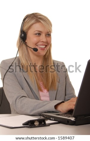 Business lady at computer with headset