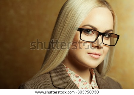 Business lady concept. Portrait of elegantly dressed young gorgeous blonde woman in trendy eyewear. Smart casual style. Close up. Copy-space. Studio shot