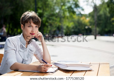 Business lady in cafe witj documents - stock photo