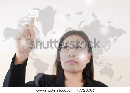 Business lady pressing mail world wide. - stock photo