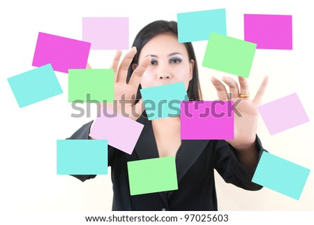 Business lady pushing on sticky note.