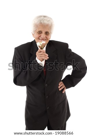 Business Lady Senior holding a flower .