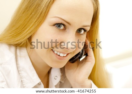 Business lady talking by phone.