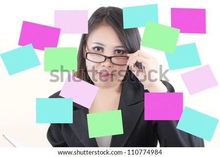 Business lady thinking with sticky note. - stock photo