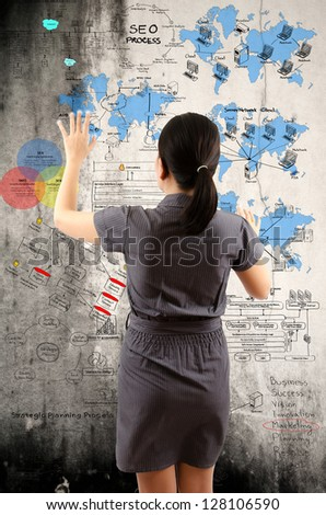 Business Lady touching Detail of Business and Technology Concept on the wall. - stock photo
