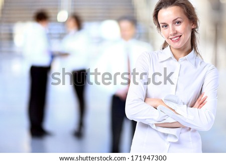 Business lady with positive look and cheerful smile posing for the camera - stock photo