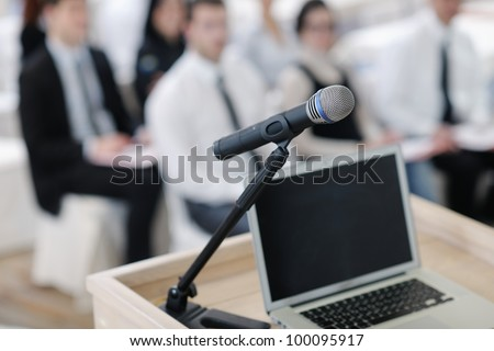 business laptop and microphotone at podium on seminar conference education