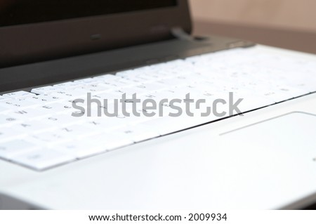 business laptop close up, shallow dof - stock photo